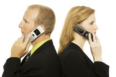 Business people with phones. Two business people use cell phones back to back Royalty Free Stock Photos