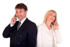 Business people on phones Stock Image
