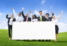 Business People With Placard Royalty Free Stock Image