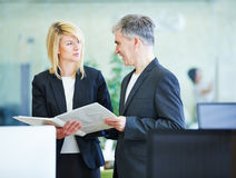 Business people planning in the offce. Two smiling business people planning work in the offce Stock Photography
