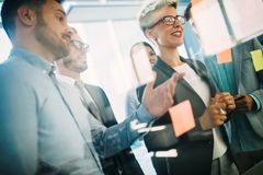 Business people planning strategy in office together. Business people planning strategy in modern office together stock image