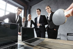 Business people play ping pong Royalty Free Stock Image