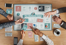 Business people playing a board game Royalty Free Stock Images