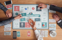 Business people playing a board game Stock Photo