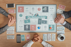 Business people playing a board game Royalty Free Stock Photos