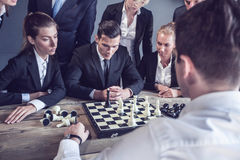 Business people playing chess Royalty Free Stock Photos