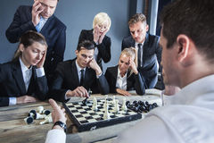 Business people playing chess Stock Images