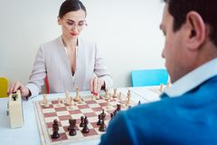 Business people playing chess stock image