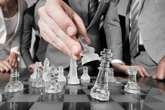 Business people playing chess Stock Photos