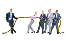 Business People Playing Tug of Wars Stock Photos