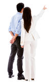Business people pointing away Royalty Free Stock Image