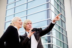 Business people pointing binoculars Stock Image