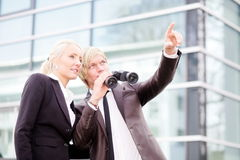 Business people pointing binoculars Royalty Free Stock Photo