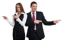 Business people pointing in different directions Royalty Free Stock Photo