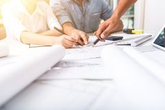 Business people pointing at document during team meeting Stock Images