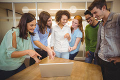 Business people pointing at laptop Royalty Free Stock Photos