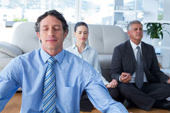 Business people practicing yoga Stock Photo