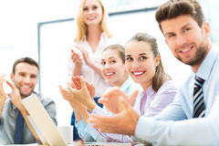 Business people at a presentation, clapping. Business team at the office Royalty Free Stock Image