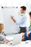 Business people at a presentation. Business people in conference room royalty free stock image