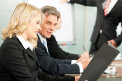 Business people - presentation within a team Stock Image
