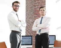Professional economists standing in office Royalty Free Stock Images