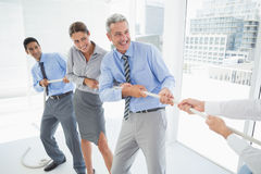 Business people pulling rope Stock Image