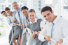 Business people pulling rope Stock Photo