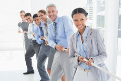 Business people pulling rope Royalty Free Stock Images