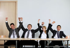 Business people punching air in office, cheering Stock Photo