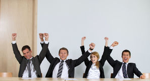 Business people punching air in office, cheering royalty free stock photos