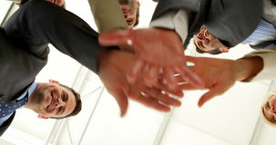 Business people putting hands together low angle view Royalty Free Stock Photo