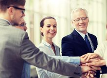 Business people putting hands on top in office royalty free stock images
