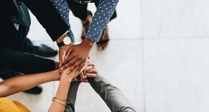 Free Business People Putting Their Hands Together Stock Image - 129432411