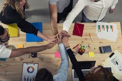 Business people putting their hands together. Concept of integration, teamwork and partnership. Business people putting their hands together in office. Concept royalty free stock images