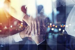Business people putting their hands together. Concept of startup, integration, teamwork and partnership. Double exposure royalty free stock images