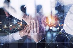 Business people putting their hands together. Concept of startup, integration, teamwork and partnership. Double exposure royalty free stock photo