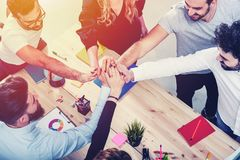 Business people putting their hands together. Concept of integration, teamwork and partnership. Business people putting their hands together in office. Concept royalty free stock photos