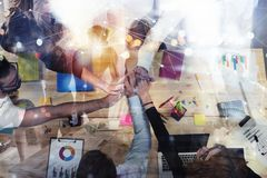 Business people putting their hands together. Concept of integration, teamwork and partnership. Double exposure. Business people putting their hands together in royalty free stock photos