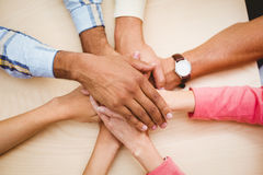 Business people putting their hands together on the table Royalty Free Stock Photography