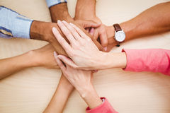 Business people putting their hands together on the table Royalty Free Stock Images