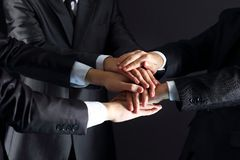 Business people putting their hands. On top of each other Royalty Free Stock Photos