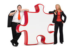 Business people with puzzle - Copyspace. Business people standing near a big red puzzle with copyspace Royalty Free Stock Image