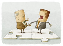 Business people puzzle handshake. Two business people on a puzzle make a handshake Stock Photography
