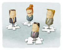 Business people on puzzle Stock Photo