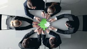 Business people and puzzle stock footage