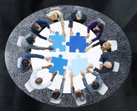 Business People with Puzzle Pieces and Teamwork Concept.  royalty free stock photos