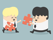Business people and puzzles Stock Photo