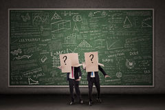 Business people and question mark Stock Photos