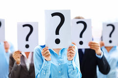 Business people with question mark. Business people standing with question mark on boards Stock Photography