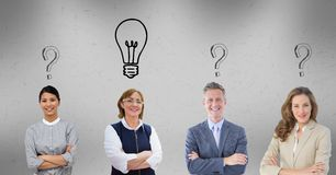 Business people with question marks and light bulb graphics over head. Digital composite of Business people with question marks and light bulb graphics over head Royalty Free Stock Photography